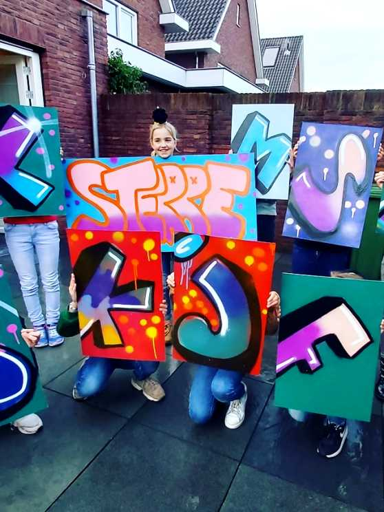 Foto 2: Creativiteit en plezier tijdens een graffiti kinderfeestje